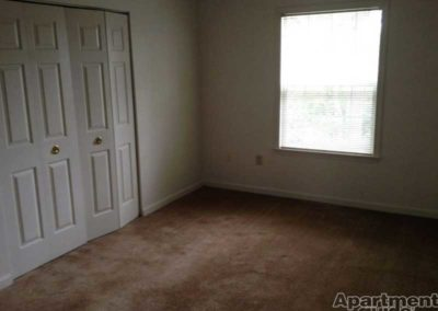 Empty bedroom space in Oak Meadows apartment