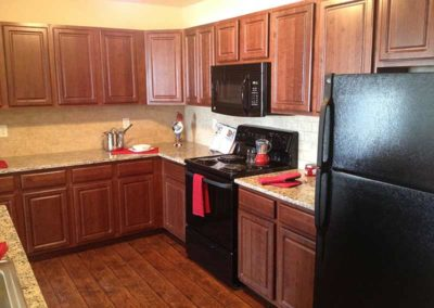 Dark cabinetry kitchen in Reading apartment for rent