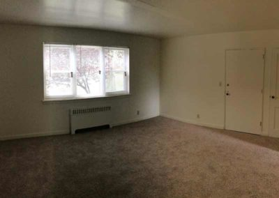 Empty living room of Reading apartment rental at Wyomissing Garden