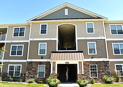 Exterior entrance of The Reserve at Manada Hill West Hanover apartments