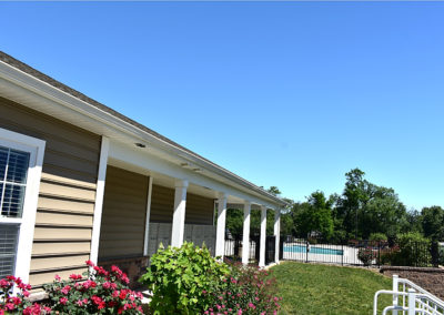 The Reserve at Manada Hill clubhouse exterior with pool at West Hanover apartments