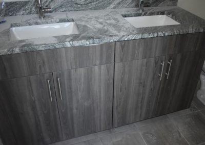 Dark granite sinks in Wyomissing rental bathroom
