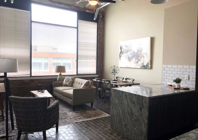 Living room and breakfast bar in The Lofts at Narrow apartment